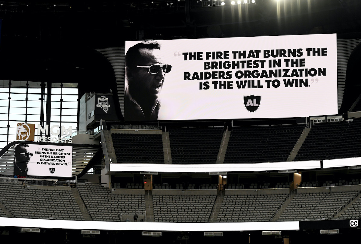 A video board displays an Al Davis quote from when he was owner and general manager of the Oakland Raiders before a game at Allegiant Stadium
