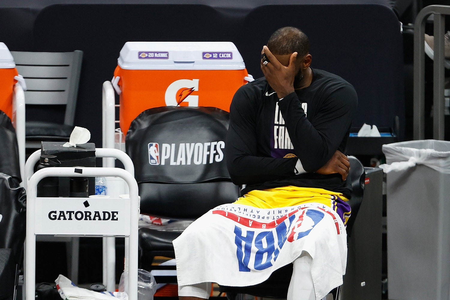 LeBron James reacts on the bench during the second half in Game 5 of the Western Conference quarterfinals against the Phoenix Suns Arena. | Christian Petersen/Getty Images