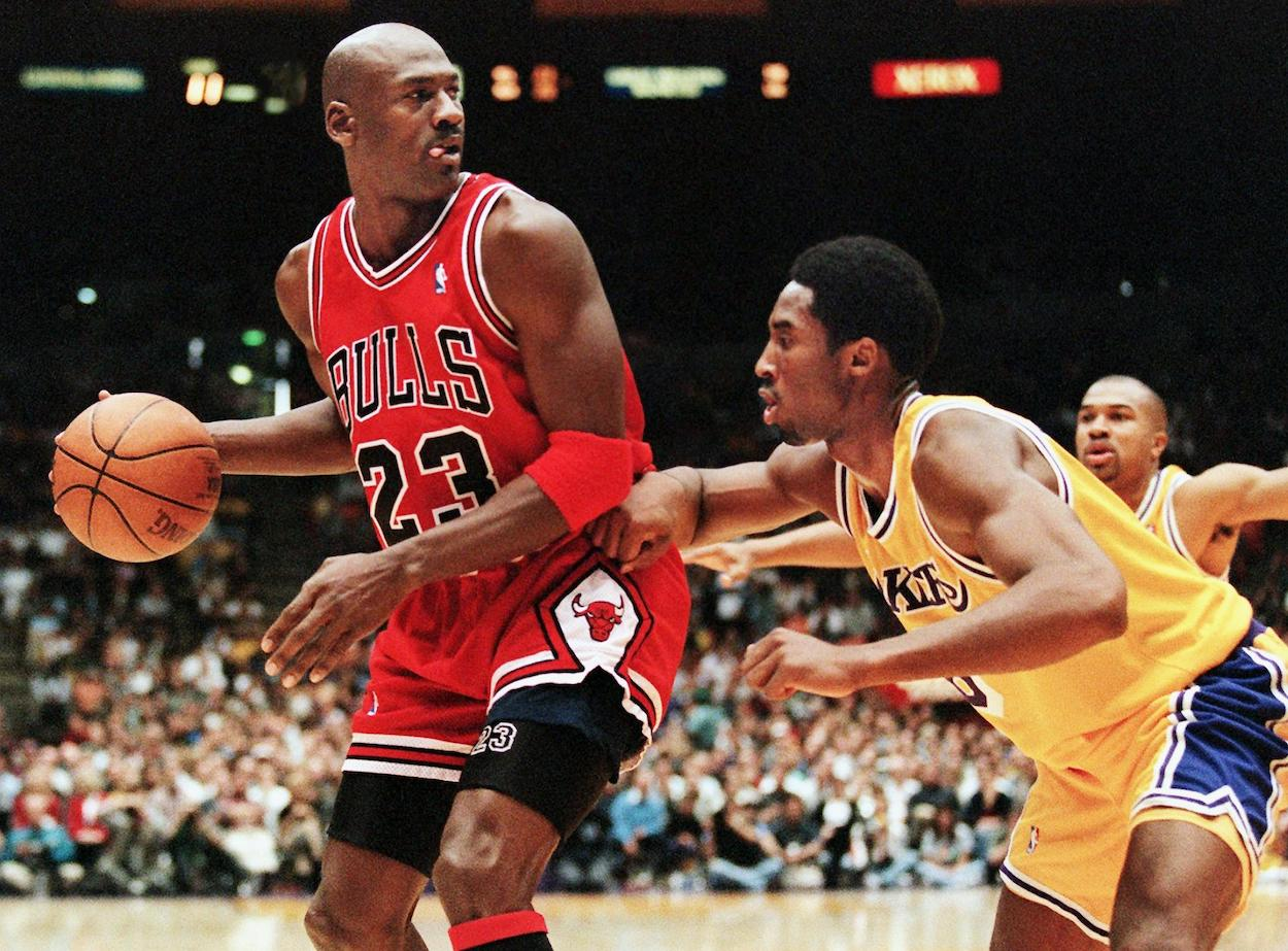 Michael Jordan of the Chicago Bulls is guarded by Kobe Bryant of the Los Angeles Lakers in 1998