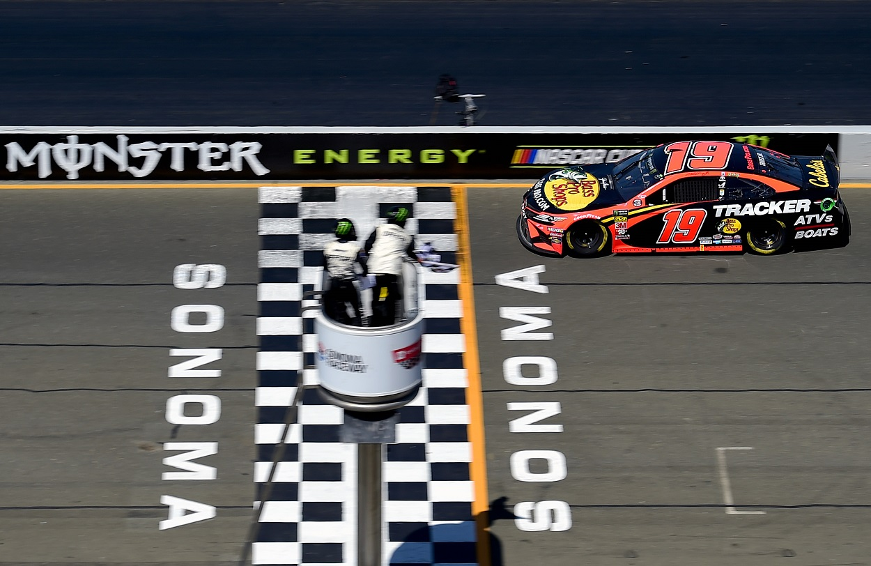 Martin Truex Jr. crosses the finish at Sonoma Raceway to win the 2019 NASCAR Cup Series Toyota/Save Mart 350