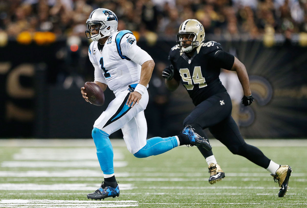 Cam Jordan of the New Orleans Saints pursues Cam Newton of the Carolina Panthers in December 2014