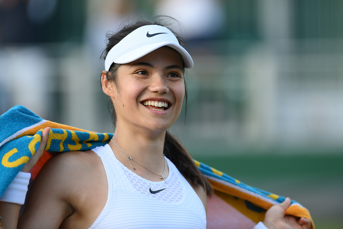 Tennis player Emma Raducanu of Great Britain smiles as she walks off the court after a match at Wimbledon 2021 in London, England   Mike Hewitt/Getty Images