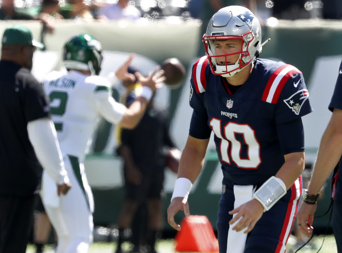 Patriots rookie quarterback Mac Jones (#10) and Jets rookie quarterback Zach Wilson (#2, left) warm up before their September 19 game